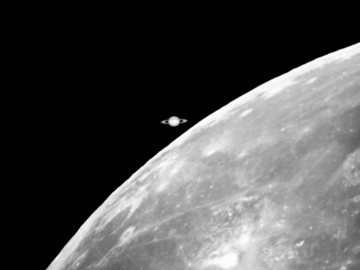 Saturn setting behind the Moon